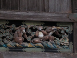 Three wise monkeys carving