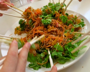 Chopsticks diving in for a Malaysian dish