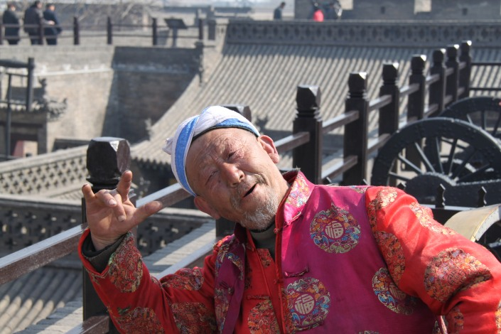 A local in Pingyao who wanted his photo taken