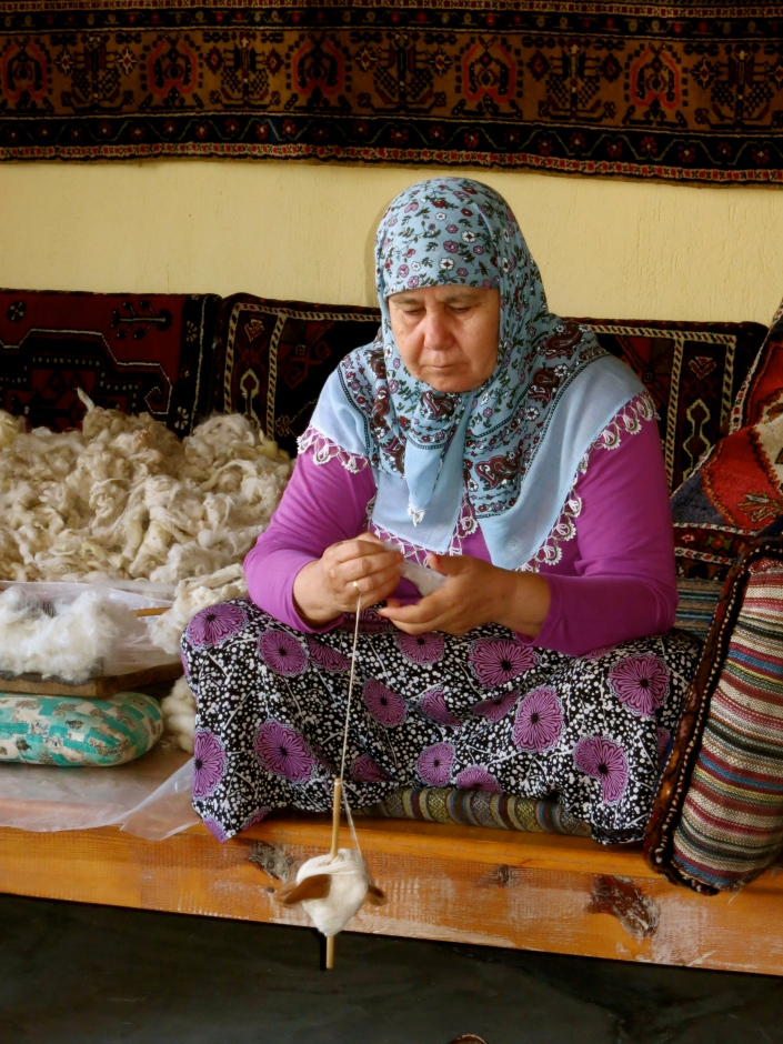 Spinning her wool